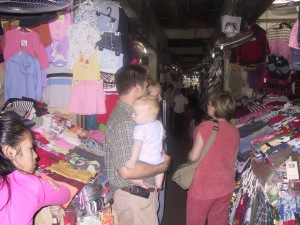shopping for baby clothes in the tight, hot open markets