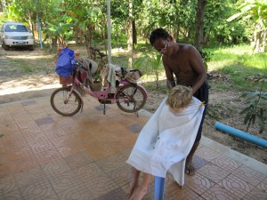 The blind traveling barber with every tool imaginable on his bike!