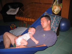 The hammock in the middle of the room serves as baby swing, rocking chair, and dads nap spot.